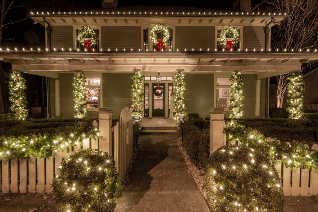 professional holiday lighting and greenery on Franklin TN home