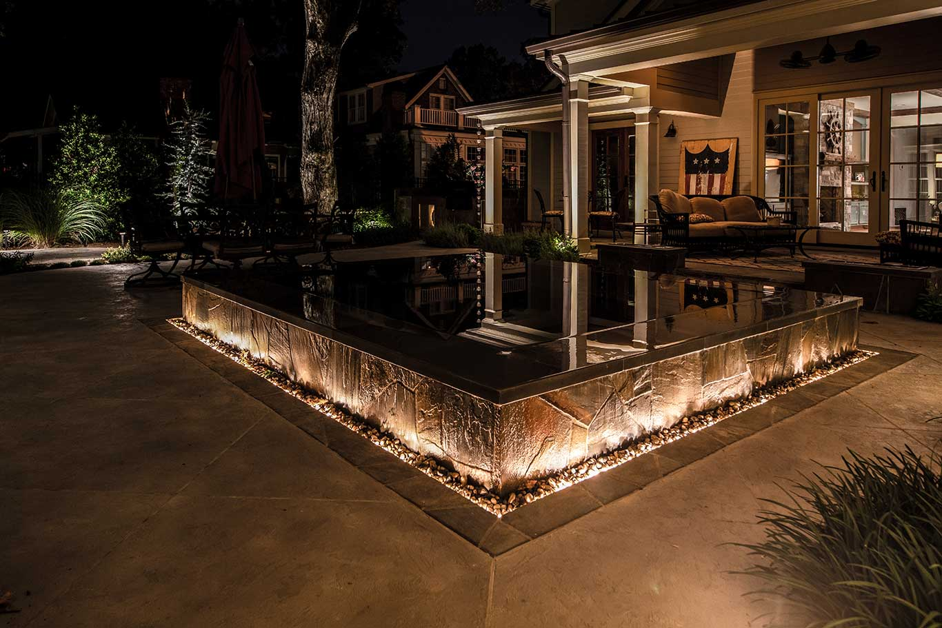 backyard courtyard lighting around infinity hot tub