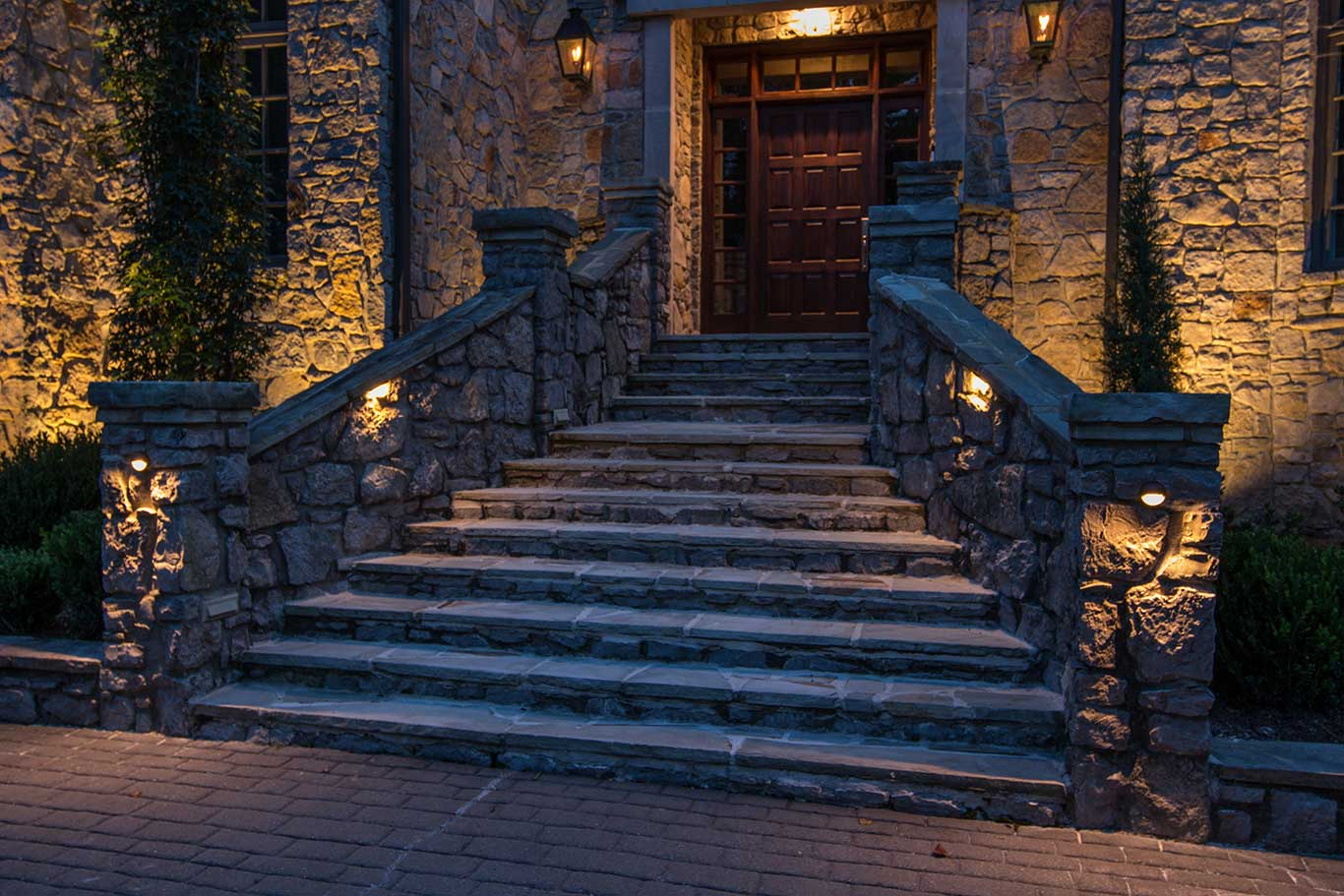 low voltage landscape lighting on stone hardscape
