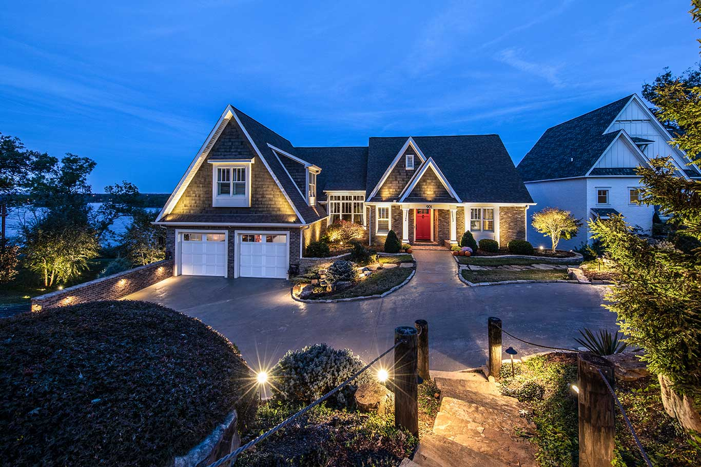 house with outdoor lighting and landscape lighting