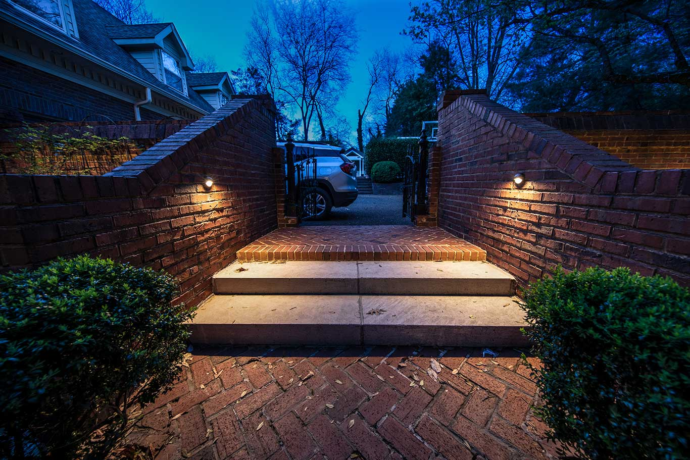 wall mounted downlights lighting steps in back courtyard