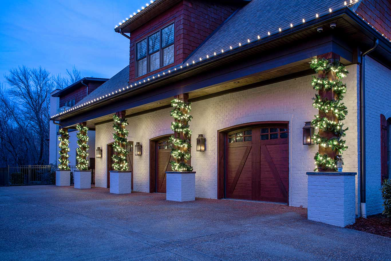wood columns wrapped in lit garland