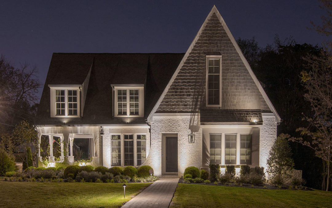 Architectural Lighting on White Brick Home