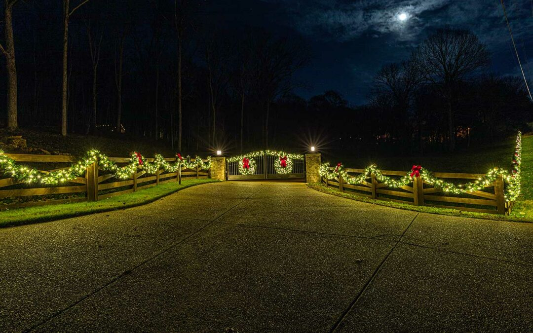 Lit Garland on Fence and Private Gate
