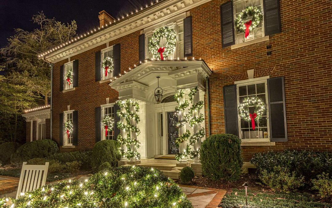 Classic Lighted Wreaths Over Windows